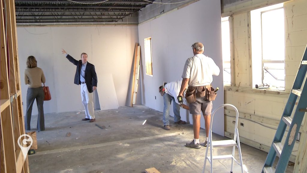Ryan Schneider of PIER Commercial Real Estate Brokerage, LLC showing a client space.
