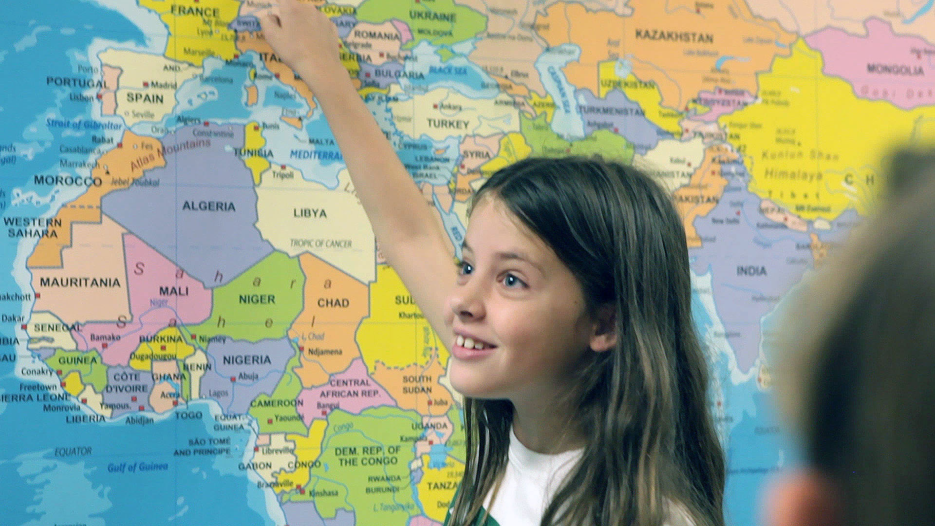 Girl Pointing at Map